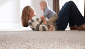 Mom child on carpet | Raby Home Solutions