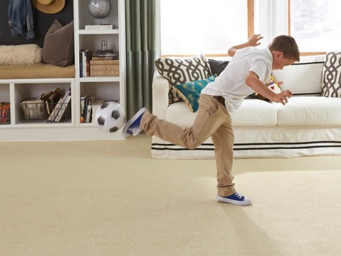 Kid playing on stainmaster carpet | Raby Home Solutions