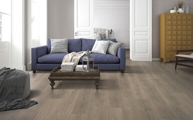 Blue sofa on Laminate floor   Raby Home Solutions